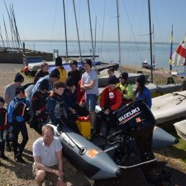 Group image of young sailors and Neil Bevington