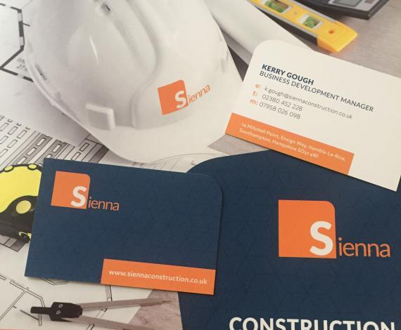 Corporate branding images of literature, business card & hard hat